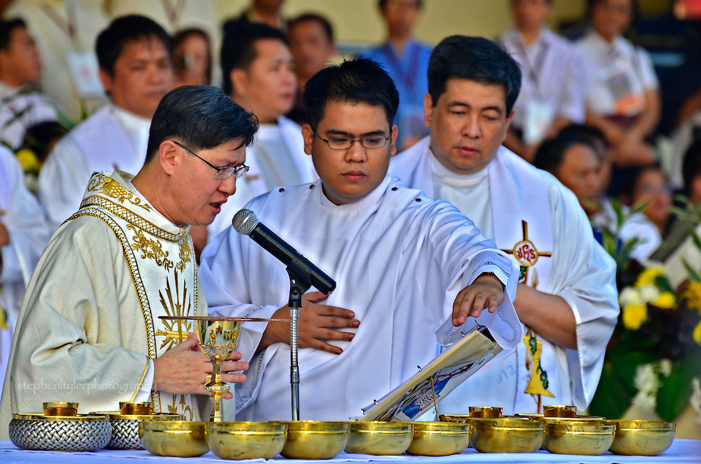 Archbishop Luis Antonio Tagle, one of the youngest ever appointed in Manila, presides over Mass and Communion during the Feast of the Black Nazarene.