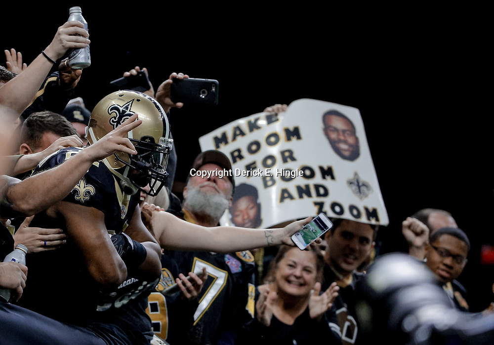 Dec 17, 2017; New Orleans, LA, USA; New Orleans Saints running back Mark Ingram (22) celebrates in the stands with fans after a touchdown during the first quarter against the New York Jets at the Mercedes-Benz Superdome. Mandatory Credit: Derick E. Hingle-USA TODAY Sports