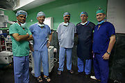 British doctors Steve Mannion and Colin Walker pictured with Nepalese doctors after performing an operation on a man who was injured when the 7.8 magnitude earthquake struck Kathmandu on 25 April 2015..<br /> <br /> Steve and Colin are both members of the UK's International Emergency Trauma Register, a volunteering scheme run by the NHS with funding from the Department for International Development. The register allows specially trained NHS medical professionals to be deployed from the UK to other countries in times of need, to help respond to humanitarian emergencies. The medics are deployed as part of the UK's Emergency Medical Team (UK EMT), which is also funded by the UK government through the Department for International Development.<br /> <br /> The 30-person UK EMT was deployed to Nepal on 26 April 2015, after the government of Nepal requested international assistance to help it respond to the 7.8 magnitude earthquake which struck the country on 25 April. The team was deployed alongside the 60-person UK International Search and Rescue Team, which is comprised of specialist urban search and rescue firefighter teams from fire &amp; rescue services around the UK.<br /> <br /> Together, members of the UK EMT and ISAR teams have helped re-open 10 operating theatres and 400 beds at the NMC hospital in Kathmandu, meaning that many more injured Nepalese can be treated and cared for there.<br /> <br /> Picture: Russell Watkins/DFID