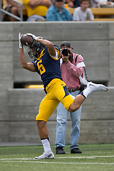 BERKELEY, CA - SEPTEMBER 12:  Wide receiver Carlos Strickland #6 of the California Golden Bears catches a pass against the San Diego State Aztecs during the third quarter at California Memorial Stadium on September 12, 2015 in Berkeley, California. The California Golden Bears defeated the San Diego State Aztecs 35-7. (Photo by Jason O. Watson/Getty Images) *** Local Caption *** Carlos Strickland