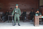 Not just any palace guards, the Royal Thai Army guards with M16A1s at the gates of the Grand Palace.