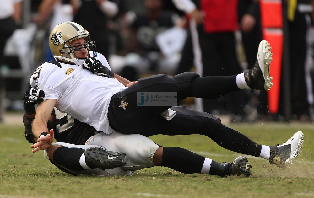 Oakland Raiders defensive tackle Desmond Bryant (90) throws down New Orleans Saints quarterback Drew Brees (9) during an NFL game on Sunday, Nov. 18, 2012 at the Oakland Coliseum in Oakland, Ca. (AP Photo/Jed Jacobsohn)
