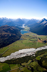 Otago District: The Dart River braids its way through the Glenorchy/Paradise Valley area northwest of Queenstown, with Diamond Lake in the distance. Richardson Mountains on left, Humboldt Mountains on the right.