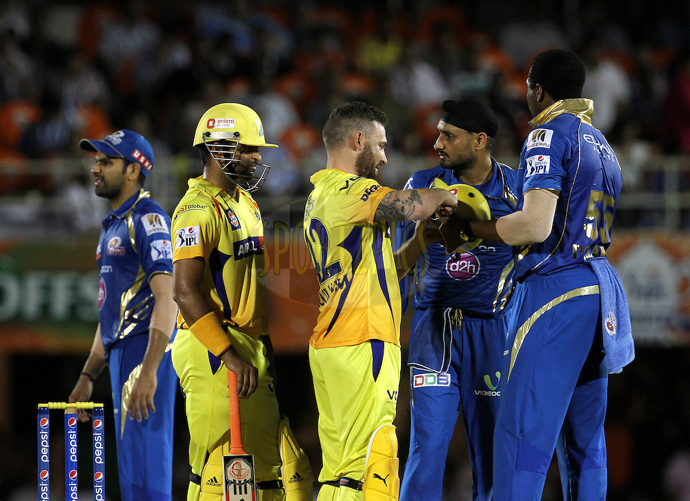 Mumbai Indians players check the helmet of Brendon McCullum of The Chennai Superkings which was hit during the eliminator match of the Pepsi Indian Premier League Season 2014 between the Chennai Superkings and the Mumbai Indians held at the Brabourne Stadium, Mumbai, India on the 28th May  2014<br /> <br /> Photo by Vipin Pawar / IPL / SPORTZPICS<br /> <br /> <br /> <br /> Image use subject to terms and conditions which can be found here:  http://sportzpics.photoshelter.com/gallery/Pepsi-IPL-Image-terms-and-conditions/G00004VW1IVJ.gB0/C0000TScjhBM6ikg