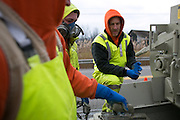 Alex Faucher, Rob Gault and Jared Vobornik of Pipe-Eye Sewer prepare to repair a manhole in Lockport, New York on Friday, December 4, 2015. Pipe-Eye is based in Bradford, Pennsylvania.