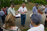 Ted Vansant of New England Solar Garden Corp. and Scott Myers City Planner explain the proposed solar panels to residents on Sterling Drive on Friday afternoon.  (Karen Bobotas/for the Laconia Daily Sun)