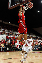 Nov 14, 2011; Stanford CA, USA;  Fresno State Bulldogs guard Steven Shepp (12) dunks in front of Stanford Cardinal guard Chasson Randle (5) during the first half of a preseason NIT game at Maples Pavilion. Mandatory Credit: Jason O. Watson-US PRESSWIRE