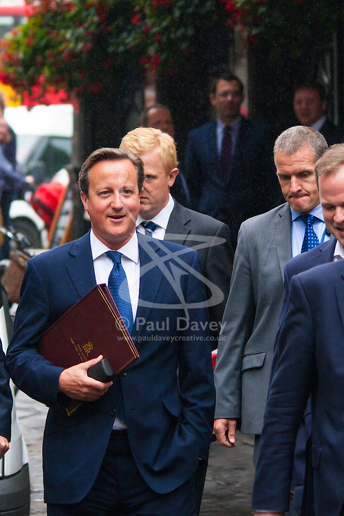 Downing Street, London, September 1st 2014. Prime Minister David Cameron walks to Parliament ahead of his address on the threat to Britain by Islamists, and the ,measures he is proposing to mitigate their effectiveness.