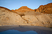 Israel, Dead Sea, The reflection of the moon and mountains.