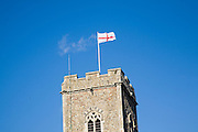 Flag of England, the St George's Cross, flying from church tower flagpole, Suffolk, England