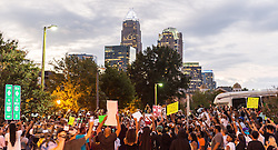 September 21, 2016 - Charlotte, North Carolina, United States of America - Sept. 21, 2016 - Charlotte, UNITED North CarolinaS - , Protestors march in Uptown Charlotte, North Carolina, United States, Wednesday 21 September 2016. This is the second day of violence that erupted after a police officer's fatal shooting of an African-American man Tuesday afternoon. (Credit Image: © Sean Meyers via ZUMA Wire)