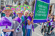 The front of the march including the deputy Mayor of London - PROCESSIONS by 14-18 NOW and Artichoke - On 6 February 1918, the Representation of the People Act gave the first British women the right to vote. Artichoke, the UK's largest producer of art in the public realm, invited women and girls to mark this moment by taking part in a major mass-participation artwork. They walk together in public processions, forming a living portrait of women in the 21st century and a visual expression of equality. celebrating the fight for suffrage. Text and textiles are at the heart of the project - the public took part in a creative programme of banner-making and 100 artists worked with community groups across the country to deliver expressive banners and iconic artworks.