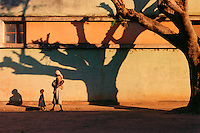 ©2002 ANGOLA. .Shadow on wall, Camacupa, Angola. .Photo: Markus Marcetic