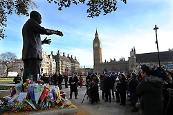 Mourners lay flowers at the statue of Nelson Mandela at Parliament Square in London, Friday, 6th December 2013, following the death Nelson Mandela, Picture by Stephen Lock / i-Images