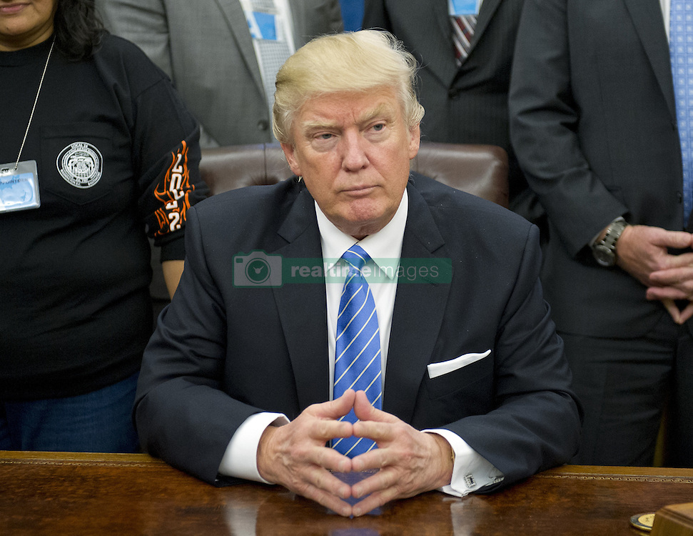 January 23, 2017 - Washington, District of Columbia, U.S. - United States President DONALD TRUMP poses for a group with American Labor leaders in the Oval Office of the White House. (Credit Image: © Ron Sachs/CNP via ZUMA Wire)