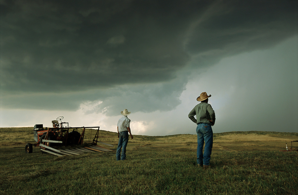 Ranchers watch approaching thunderstorm in the Sandhills of Nebraska.