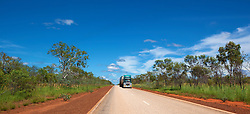 A roadtrain drives along the main highway to Fitzroy Crossing in the wet season.