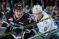 KELOWNA, CANADA - NOVEMBER 25: Justin Kirkland #23 of Kelowna Rockets is checked by Scott Eansor #8 of Seattle Thunderbirds on November 25, 2015 at Prospera Place in Kelowna, British Columbia, Canada.  (Photo by Marissa Baecker/Getty Images)  *** Local Caption *** Justin Kirkland; Scott Eansor;