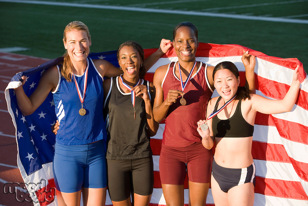 Team of American female athletes celebrating victory