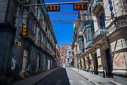Empty street in the center of La Paz. During elections period in  Bolivia, the country faces several restrictions, like no alcohol for sale 48 hours before and 12 after the election; no public gatherings, shows of any kind until the political parties made their speeches on the election night; its completely forbidden the circulation of any vehicles, private or governmental except with the permit from the Electoral Tribunal, which means it would be basically no cars, buses or anything circulating in the city; no long distance buses, the terminal will be close from Saturday until Monday and even flights will not be allowed except the ones leaving the country or the international ones doing stop-over. It is a completely shut down of the country.