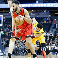 18 November 2016: Toronto Raptors guard Cory Joseph (6) drives past Denver Nuggets guard Jamal Murray (27) on a screen set by Toronto Raptors center Jakob Poeltl (42) during the Toronto Raptors 113-111 OT victory over the Denver Nuggets, at the Pepsi Center, Denver, Colorado, USA.