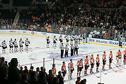 Robert Morris and RIT players line up for the national anthem before the Atlantic Hockey final at the Blue Cross Arena in Rochester on Saturday, March 19, 2016.