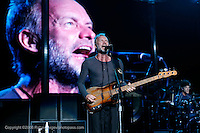 The Police performing at Jones Beach on August 4, 2008. .Sting - lead vocals and bass (beard).Andy Summers - guitar.Stewart Copeland - drums.