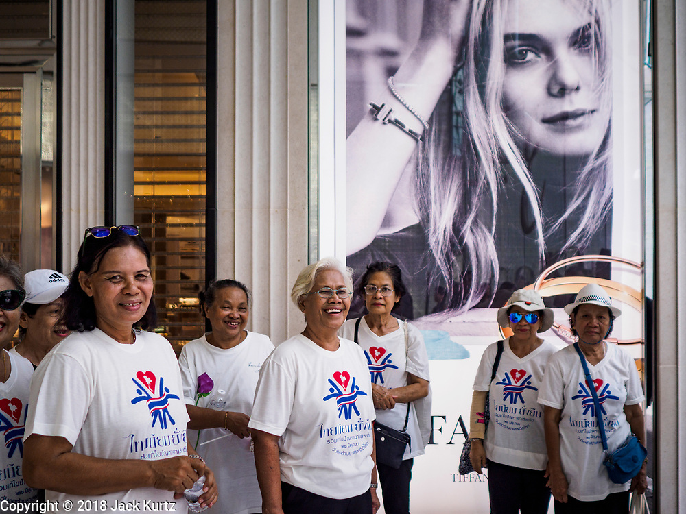 26 JUNE 2018 - BANGKOK, THAILAND: Women from the Khlong Toei community in front of the Tiffany & Co store in Emporium Mall in Bangkok.    PHOTO BY JACK KURTZ