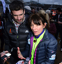 Matthew Robertson (husband) with Davina McCall, British presenter takes part in photocall as she ends her Sport Relief challenge in the capital having cycled, swam and run over 500 miles from Edinburgh in seven days, in front of the Tate Modern, Southbank, London, United Kingdom. Friday, 14th February 2014. Picture by Nils Jorgensen / i-Images