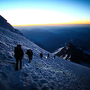 Climbers turn off their headlamps at first light during a summit of Mount Rainier on June 30, 2015. The iconic Pacific Northwest volcano is a popular challenge for mountaineers.  (Joshua Trujillo, seattlepi.com)