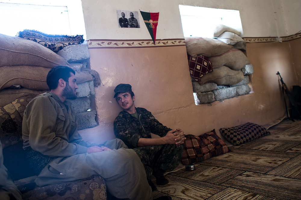 In embatteled Shingal, HPG and YPS fighters sitting in an abandoned house that serves as a military base. Shingal (Sinjar), Iraq, August 27, 2015