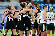 Emily Naylor and Rose Keddell of New Zealand celebrate after winning the bronze medal match between New Zealand and South Africa. Glasgow 2014 Commonwealth Games. Hockey, Bronze Medal Match, Black Sticks Women v South Africa, Glasgow Green Hockey Centre, Glasgow, Scotland. Saturday 2 August 2014. Photo: Anthony Au-Yeung / photosport.co.nz