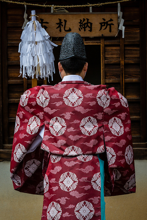 A shinto pries reads a morning prayer at Yasaka Shrine