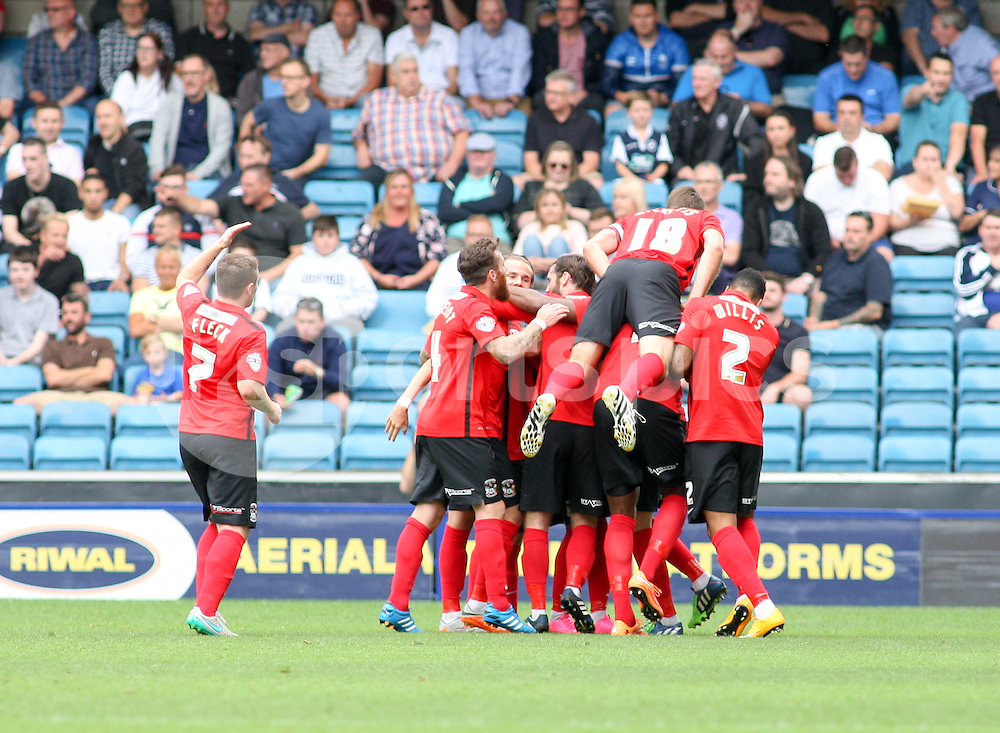 Ruben Lameiras of Coventry City is congratulated after making it 2-0 during the Sky Bet League 1 match between Millwall and Coventry City at The Den, London, England on 15 August 2015. Photo by Edmund  Boyden.