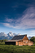 Mormon barn with Grand Teton in the backgound.  Shot early morning, Teton National Forest, WY.  Just North of Jackson