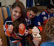 20111101 - Hewlett, NY -  Michelle Borokhovich, 3rd grade, has her jersey signed by New York Islander Nino Niederreiter (25) during a visit to students at Hewlett Elementary School. Photo by Isabel Slepoy /  LI Herald