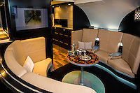 ABU DHABI, UAE - FEBRUARY 8, 2015: A luxurious lobby is available in the upper deck of the new A380. Etihad Airways is greatly inspired and influenced by the high hospitality industry standards.