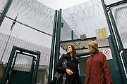 A female prisoner just released from HMP Downview Women's Prison is greeted by a volunteer to help her get to her destination, this is when the released women are most vulnerable. HMP Downview Women's Prison has a dedicated resettlement unit providing opportunities for work and education outside the prison.