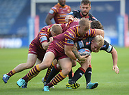 Huddersfield Giants defenders wrap up Gabe Hamlin of Wigan Warriors during the Betfred Super League match at the John Smiths Stadium, Huddersfield<br /> Picture by Richard Land/Focus Images Ltd +44 7713 507003<br /> 12/07/2018