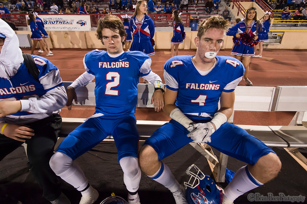 Christian Brothers Falcons Gunnor Faulk, (2), sits with friend and teammate Spencer Webb (4), as they host the Bencia Panthers in the Sac-Joaquin Section Division III playoff opener at Hughes Stadium, Friday Nov 10, 2017.<br /> photo by Brian Baer