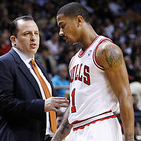 29 January 2012: Chicago Bulls head coach Tom Thibodeau talks to Chicago Bulls point guard Derrick Rose (1) during the Miami Heat 97-93 victory over the Chicago Bulls at the AmericanAirlines Arena, Miami, Florida, USA.