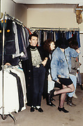 Stallholder in Camden with customers. UK, 1980s.