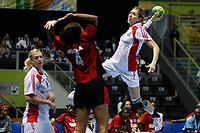 20111216: SAO PAULO, BRAZIL -<br />  XX World Handball Angola x Rússia in Ibirapuera Gym at Sao Paulo, Brazil.<br /> In photo: Fatima (Angola) and Levina  (Russia). <br /> PHOTO: CITYFILES