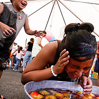 Ethan Garcia, 5, left, laughs after he executed revenge on his older sister Ariel Garcia, 11, by pushing her head into a tub of water while she bobbed for apples August, 26, 2007, in Odessa, Texas.