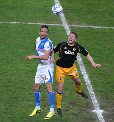 Bristol Rovers' Kaid Mohamed battles for a high ball with Mansfield Town's Jamie McGuire - Photo mandatory by-line: Alex James/JMP - Mobile: 07966 386802 03/05/2014 - SPORT - FOOTBALL - Bristol - Memorial Stadium - Bristol Rovers v Mansfield - Sky Bet League Two