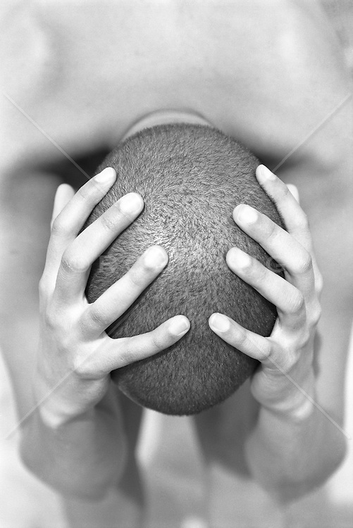 woman holding her head after it was shaved