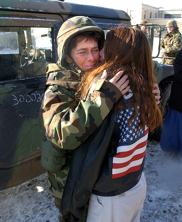 2/12/03  Photo by Mara Lavitt-Goodbye 1<br /> ML0052E #9166<br /> Brainerd Armory, Hartford:  SSG Jackie Milhomme of Hartford left and her 10-year old neice Jenny Milhomme of Willimantic tearfully embrace before Jackie leaves for Ft. Drum with the convoy.