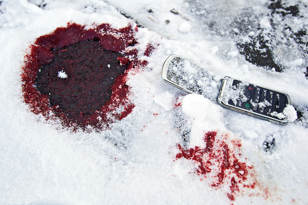 The victim's cell phone was found Thursday afternoon next to the blood soaked snow where he was found by a taxi driver and transported to Kootenai Medical Center by ambulance where he was treated and released.