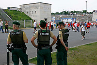 Photo: Glyn Thomas.<br />England v Trinidad & Tobago. Group B, FIFA World Cup 2006. 15/06/2006.<br /> German police keep a close watch over England fans as they arrive at the Frankenstadion in Nuremburg.
