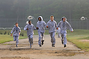 As they near the finish line of a timed seven-mile run passing Matheus Alves of Framingham, Abraham Gonzales of Framingham, #194, Anthony Charter of Hubbardston, #110, Brendan Gay of Concord, #103, and Austin Alfredson of Middleton, #9, hold hands.